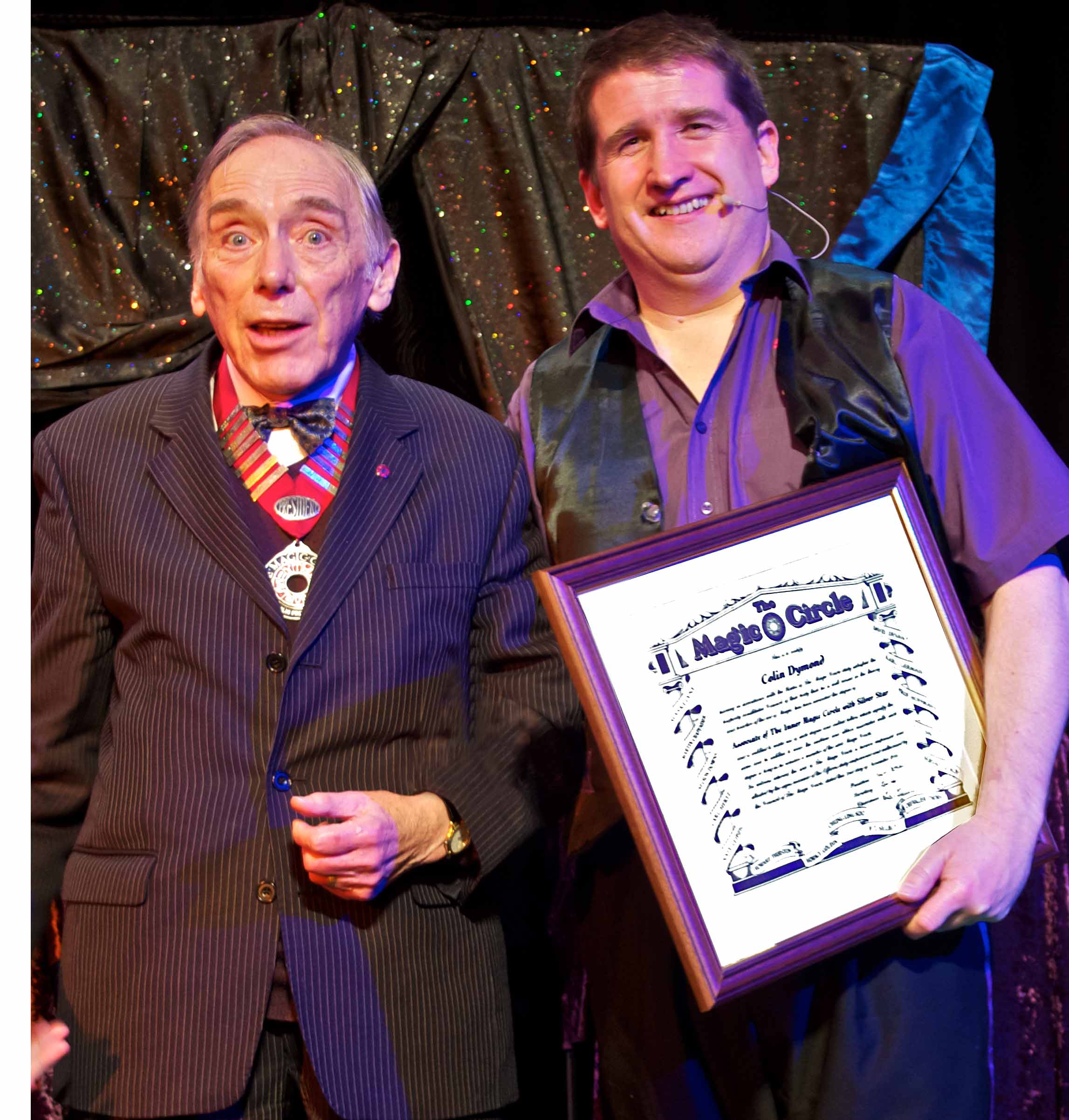Colin receiving his A.I.M.C. from the president of The Magic Circle, Jack Delvin.